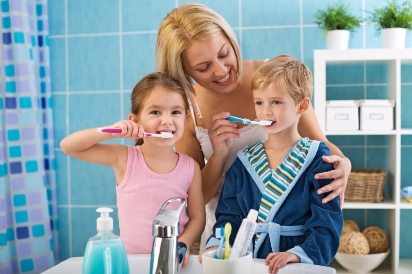 mom-brushing-kids-teeth-min.jpg